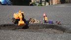 Toys and a pothole