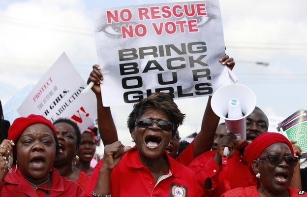 A woman attends a demonstration in Lagos, Nigeria, calling on the government to increase efforts to rescue kidnapped girls (5 May 2014)