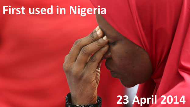 TEXT: First used in Nigeria, 23 April 2014 IMAGE: A woman with her head bowed at a rally for he missing girls in Nigeria