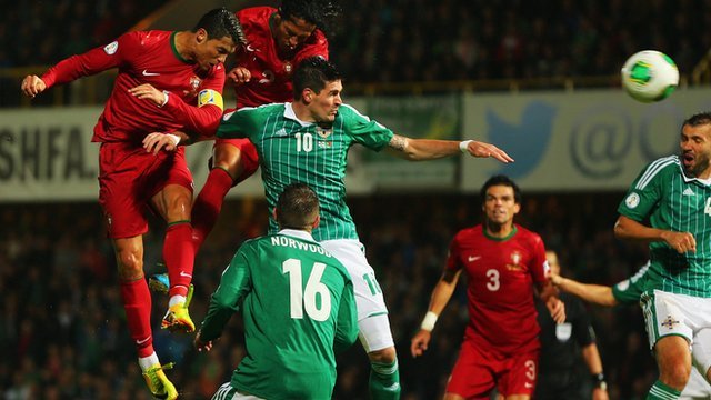 Portugal's Cristiano Ronaldo scores against Northern Ireland