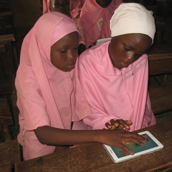 Pupils with tablet computer