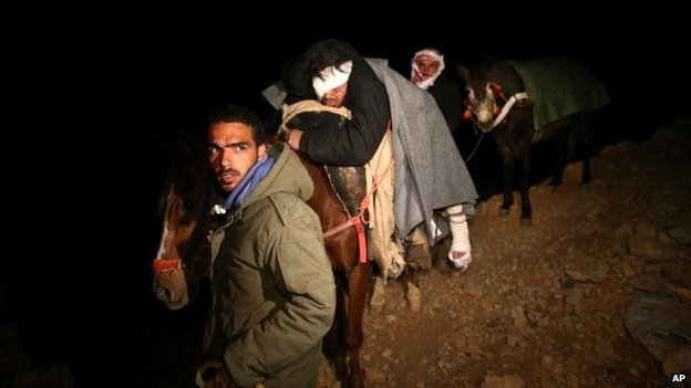 A man is taken into Lebanon on a donkey after being injured by a tank shell explosion in Beit Jinn (20 April 2014)