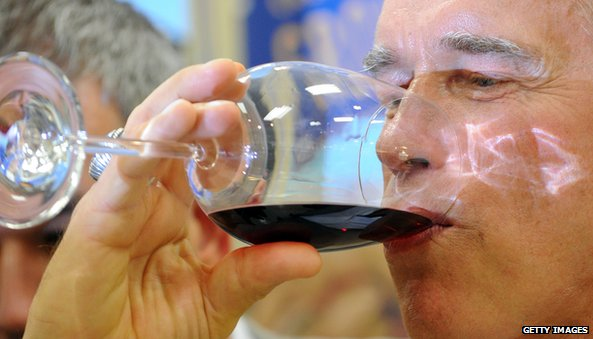 Arnold Schwarzenegger drinking wine