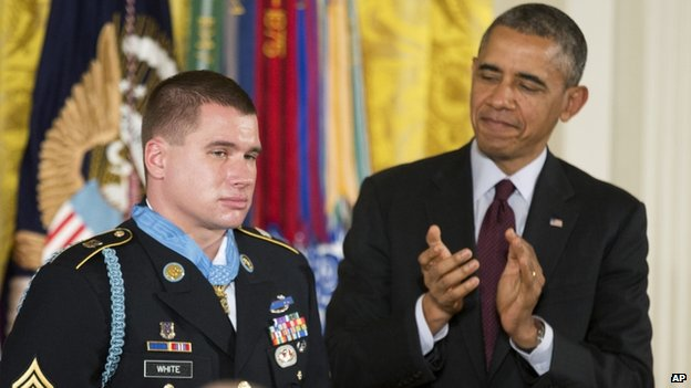 President Barack Obama (right) applauds after awarding the Medal of Honour to former Army Sergeant Kyle White in Washington on 13 May 2014