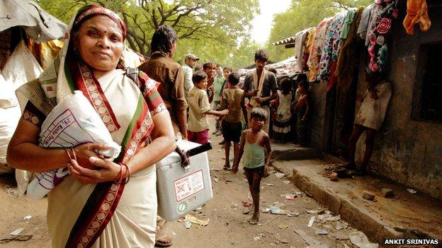 Sita Devi outside a market stall