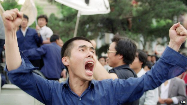 Picture dated 17 May 1989 shows a Chinese worker shouting pro-democracy slogans during a mass rally in Beijing streets in support of student hunger strikers gathered at Tiananmen Square, the scene of the mass pro-democracy protest led by students against the Chinese government