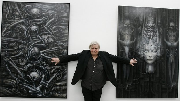 HR Giger with his artworks