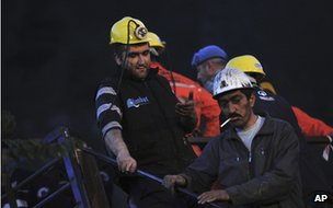 Miners wait outside a coal mine in Soma, western Turkey, early Wednesday 14 May 2014