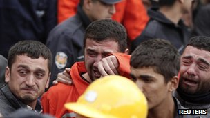 Relatives of miners who were killed or injured in a mine explosion react as rescuers work in Soma in Turkey on 14 May 2014