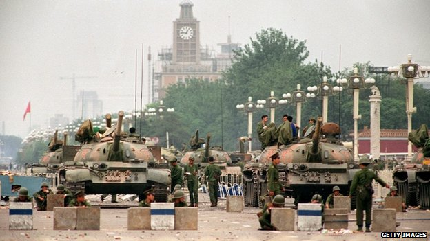 The People's Liberation Army (PLA) tanks guard a strategic Chang'an Avenue leading to Tiananmen Square 6 June 1989