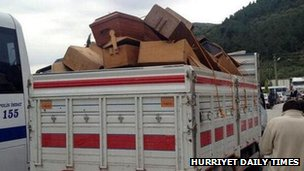 Coffins on the back of a truck