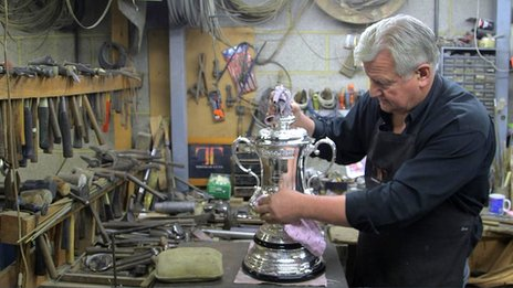 Kevin Williams works on the FA Cup trophy