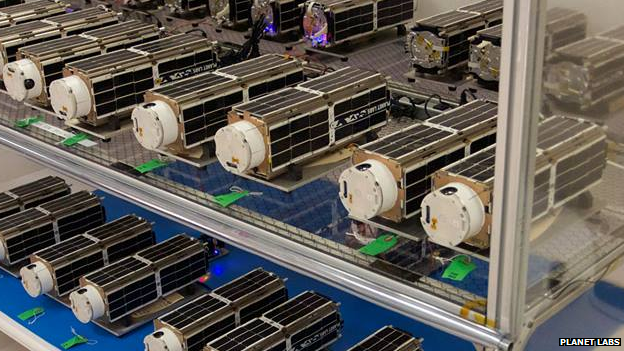 Dove cubesats on shelves