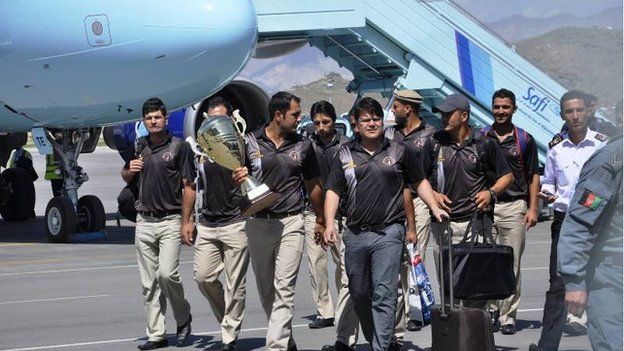 The victorious Afghan cricket team returned to a sombre homecoming