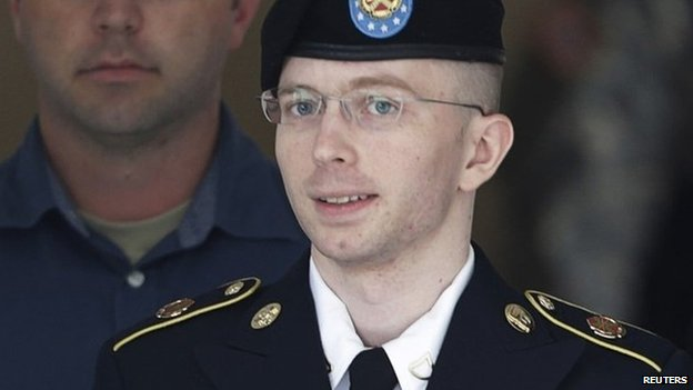 US Army Private First Class Chelsea Manning (C) departs the courthouse at Fort Meade, Maryland 30 July 2013