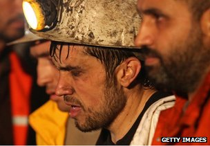 A miner is helped to safety from the disaster site in Soma, western Turkey, 14 May