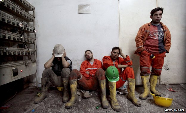 Exhausted miners rest as they await their trapped friends on 14 May 2014 in Soma, Turkey.