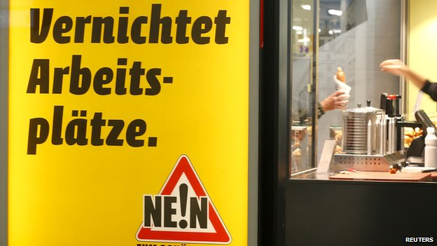A poster against minimum wage in front of a snack bar in Zurich