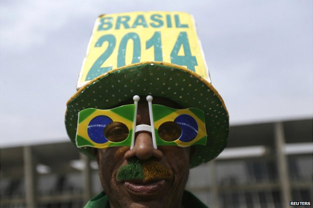 A soccer fan poses outside the building where Luiz Felipe Scolari announced the Brazilian squad for the 2014 World Cup - 7 May 2014