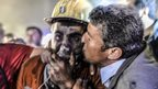 Man kisses his son rescued from the coal mine in Soma, Manisa province, Turkey, on 14 May 2014