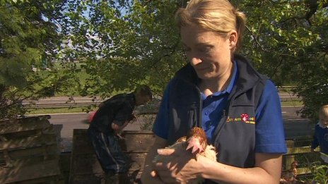 Emma Billington with a chicken