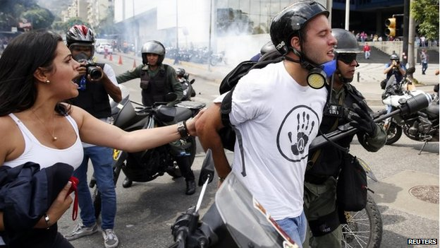 Police detain an anti-government protester during an anti-governemnt protest in Caracas, May 14, 2014.