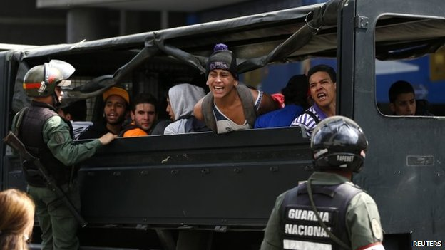 Anti-government protesters shout from a truck after being detained in Caracas, May 14, 2014.