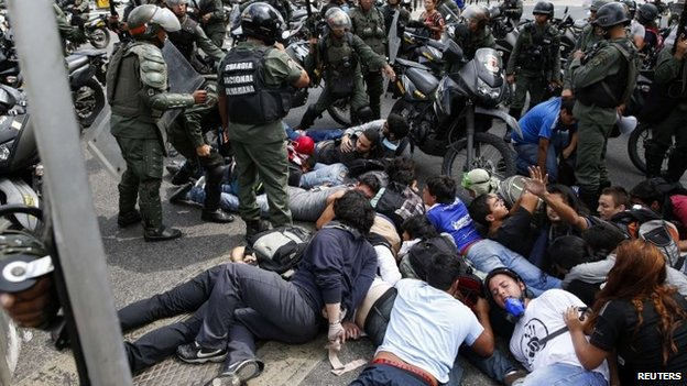 Police detain a group of anti-government protesters during a protest in Caracas, May 14, 2014.
