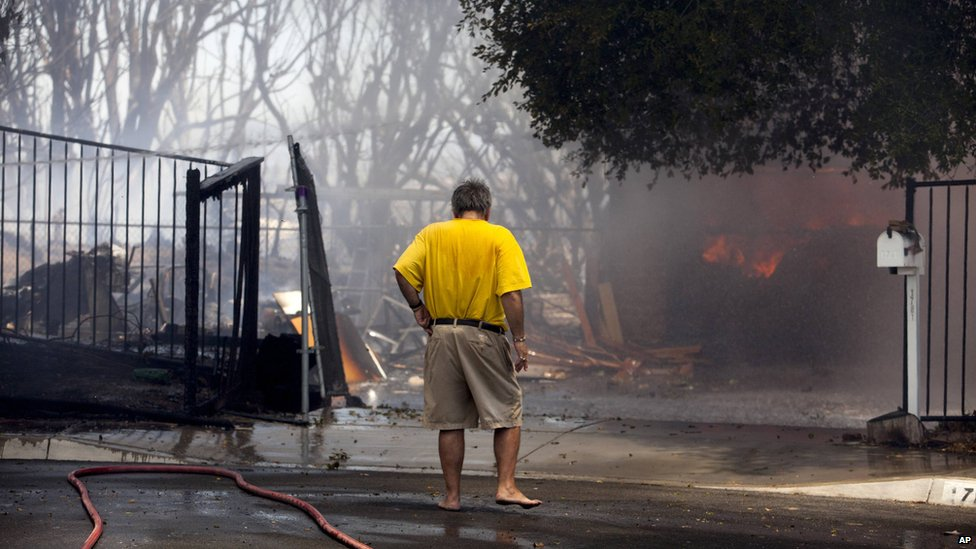 A man watched a house burn in Carlsbad, California, on 14 May 2014