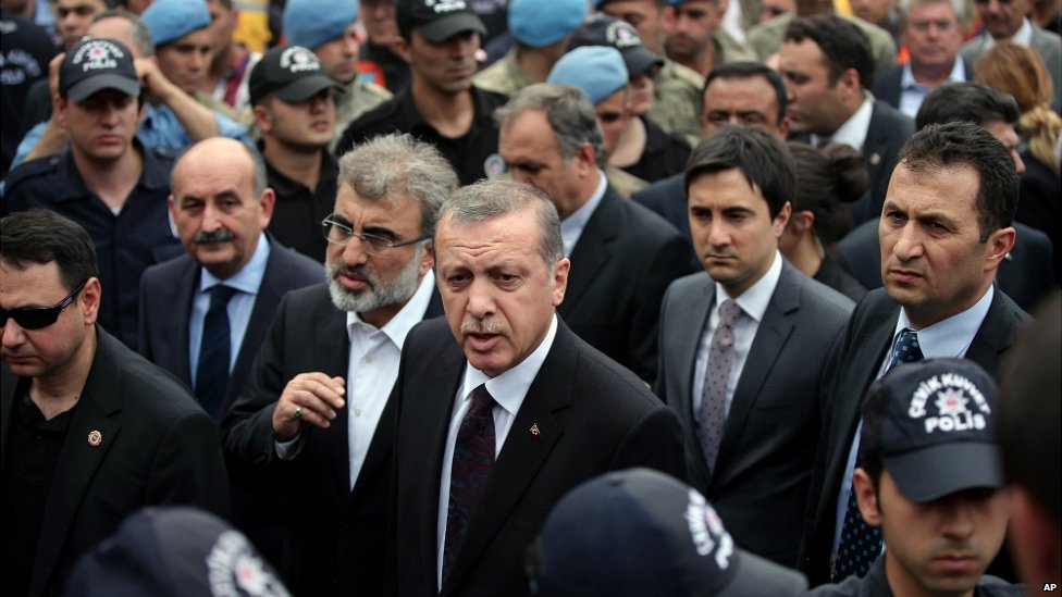 Prime Minister Erdogan, centre, is surrounded by security members as he visits the coal mine in Soma - 14 May 2014
