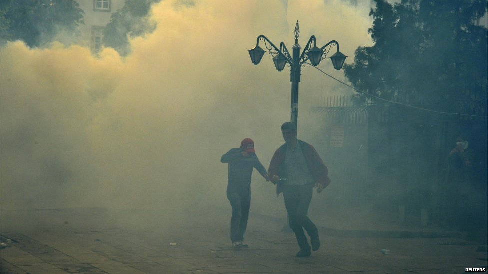 Riot police fire tear gas against protesters in Ankara who blame the ruling AK Party for the mining disaster - 14 May 2014