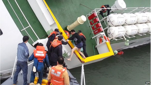 Screen grab taken from a video released by Korea Coast Guard on 28 April shows the sunken South Korea ferry Sewol captain Lee Joon-Seok wearing a sweater and underpants being rescued from the tilting vessel before it sank on 16 April