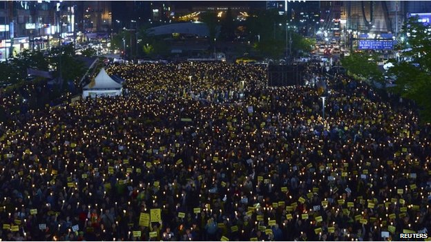 People attend a candlelight vigil to commemorate victims of the sunken Sewol passenger ferry in Ansan on 10 May