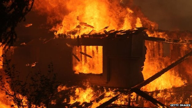 A house is consumed by a wildfire in San Marcos, California, 14 May 2014