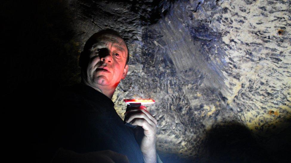 Paul O'Shea in his cave