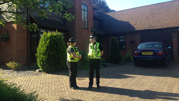 Police outside the home of Paul and Sandra Dunham