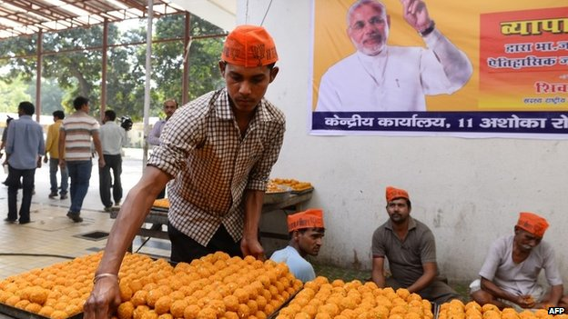 A BJP worker makes traditional sweets at the party headquarters in Delhi on May 15, 2014