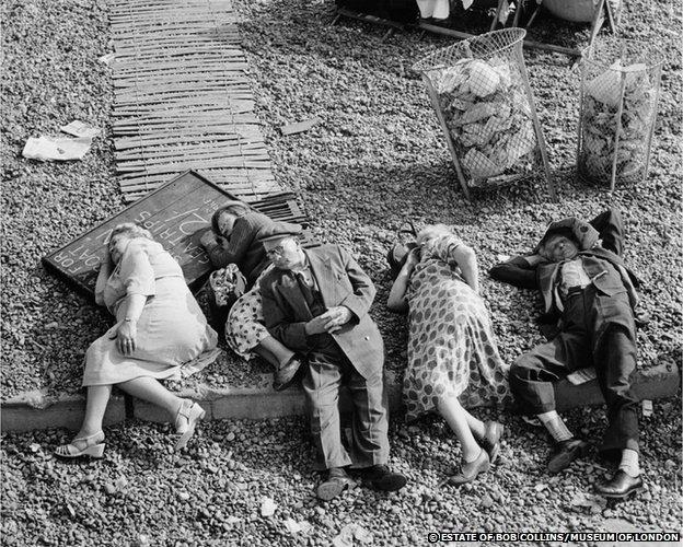 Pensioners asleep on the beach, Brighton, c.1950
