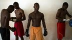 Men take part in Thai boxing training at the Barthelemy Boganda stadium in Bangui, the capital of  Central African Republic