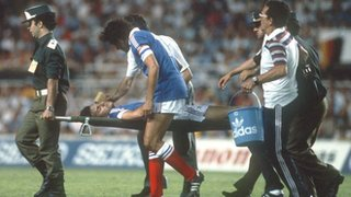 France's Patrick Battiston is stretchered off the pitch after being fouled by West Germany goalkeeper Harald Schumacher
