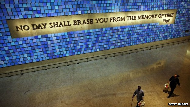 A wall with a quote from Virgil and featuring 2,983 panels for each victim is viewed during a tour of the National September 11 Memorial Museum 14 May 2014