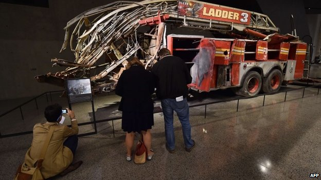 Remains of a New York City Fire Department Ladder Company 3 truck just outside the Historical Exhibition area during a press preview of the National September 11 Memorial Museum at the World Trade Center 14 May 2014