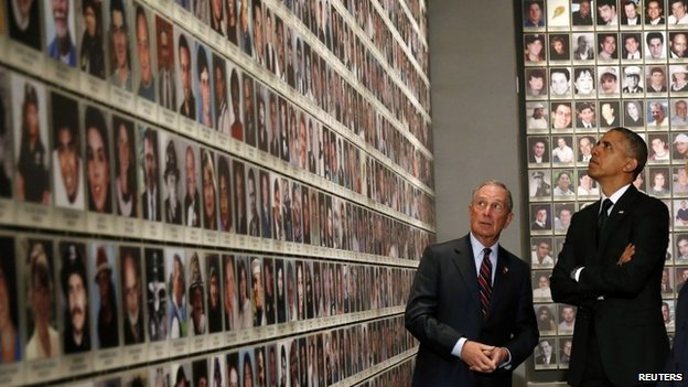 US President Barack Obama (R) and former New York Mayor Michael Bloomberg look at the faces of those who died during the 9/11 attacks at the National September 11 Memorial Museum in New York 15 May 2014