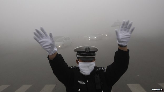 Chinese policeman in smog-filled city