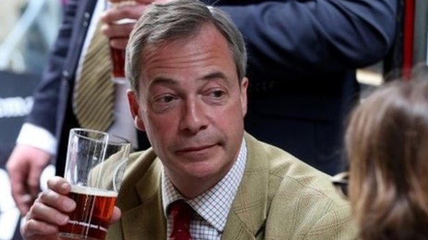 Nigel Farage holding a pint during a visit to a pub in Bath