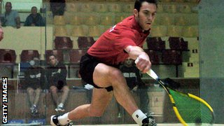 David Evans playing squash