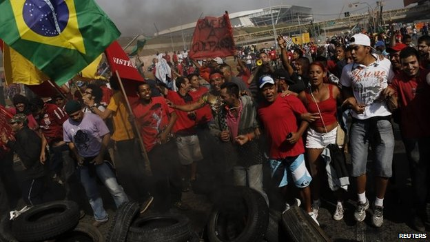 Members of the Workers Without a Roof Movement protest near the Arena Corinthians stadium in Sao Paulo against the upcoming Fifa World Cup (15 May 2014)