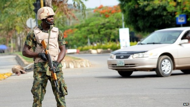 A soldier on patrol in Abuja amid protests over the mass abduction of schoolgirls in northern Nigeria - 6 May 2014