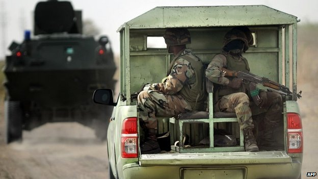 Nigerian soldiers on patrol in the north of Borno state - 5 June 2013