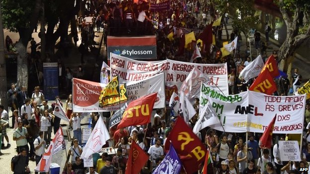 People march during a protest in Rio de Janeiro on May 15, 2014.